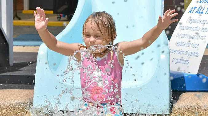 Kiarah Broomham, 3, has a quick way to chill out at Nambour swimming pool.