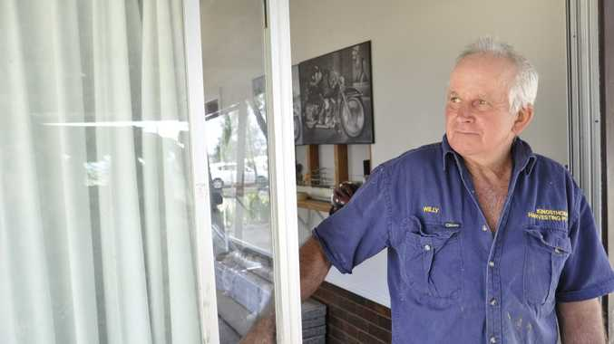 Home invasion victim William Rochford looks out of a sliding door at his Kingsthorpe home.