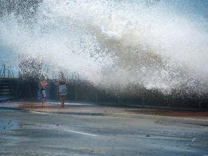 Stunning photos of waves crashing over seawall emerge