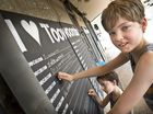 Declan (front) and Hunter Hales write why they love Toowoomba on blackboards in Margaret and Dent Streets.