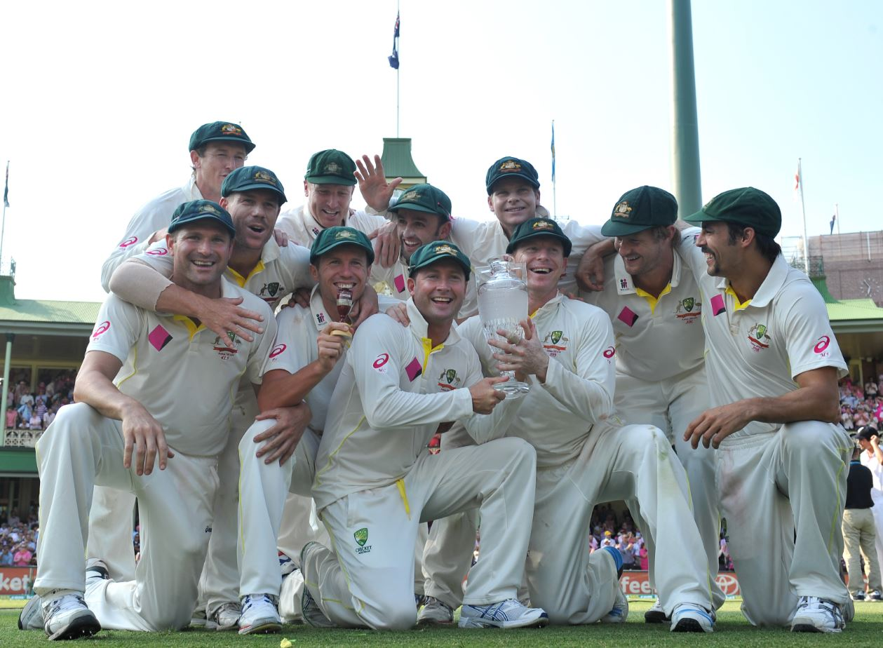 Australian cricket players pose for a photograph after defeating England in the fifth Ashes Test at the SCG in Sydney, Sunday, Jan. 5, 2014.