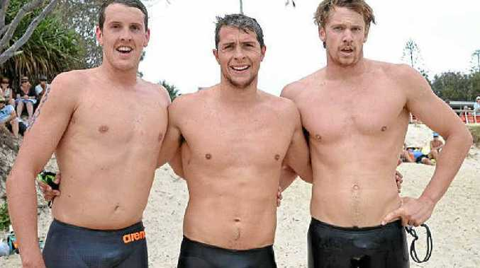 ALL SWUM OUT: Sam Sheppard (centre), winner of the men's 2km race at this year's Evans Head Ocean Swim, celebrates a great day of competition with second-placed Rich Grimsey (right) and Josh Richardson, who finished third.