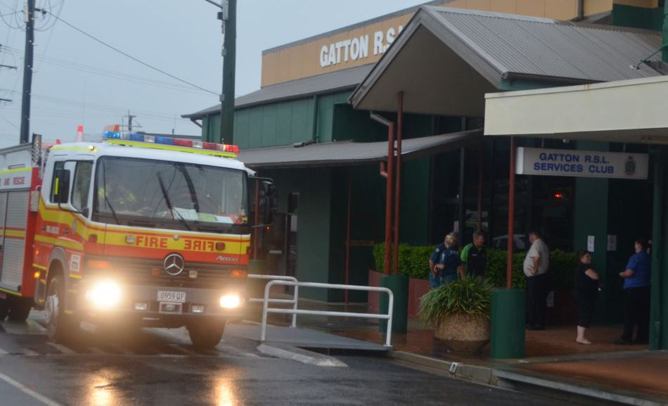 Firies attend the Gatton RSL after lightning struck on Crescent St outside the club forced an emergency evacuation on Monday afternoon.