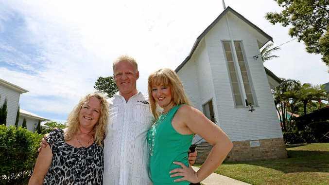 Brenda Stuttle with husband Rob and Jayde Keeley at their newly-refurbished church in Tumbulgum. Photo: Nolan Verheij-full