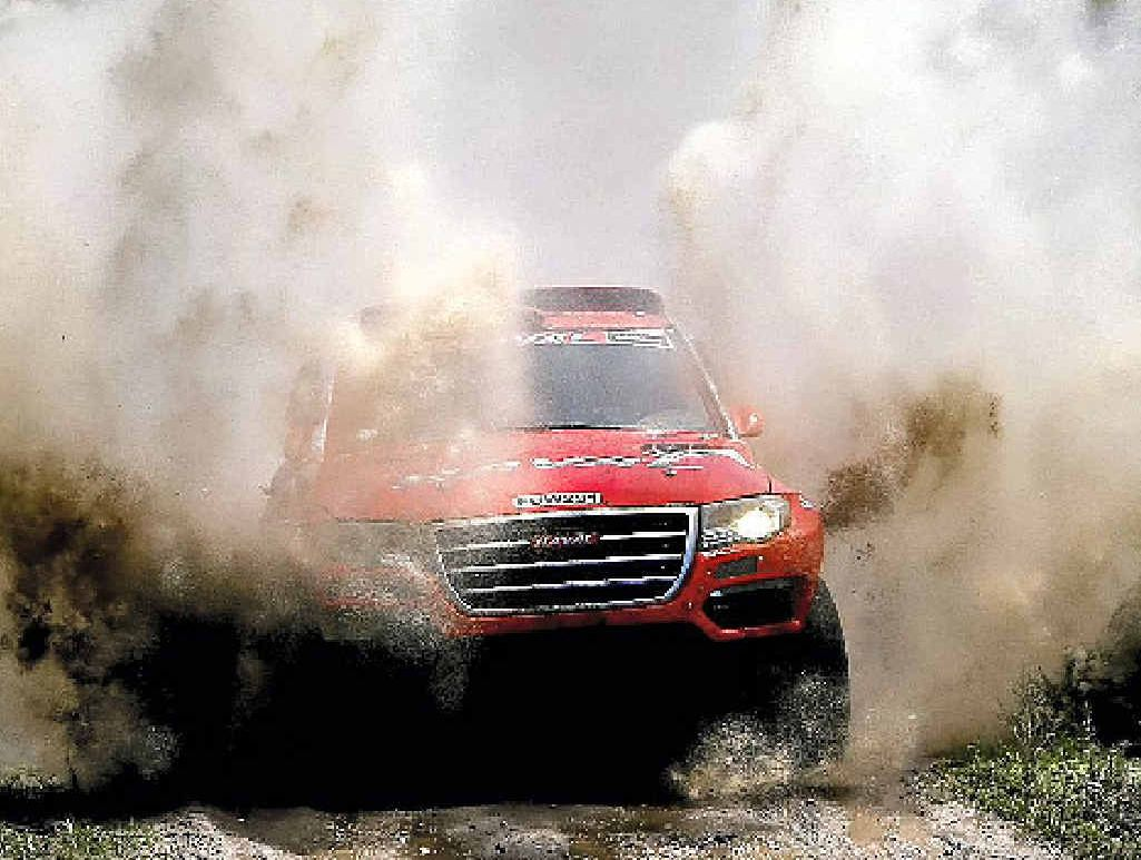 LEADER: Haval driver Carlos Sousa and co-pilot Miguel Ramalho race through a creek during the first stage of the Dakar Rally in Argentina.