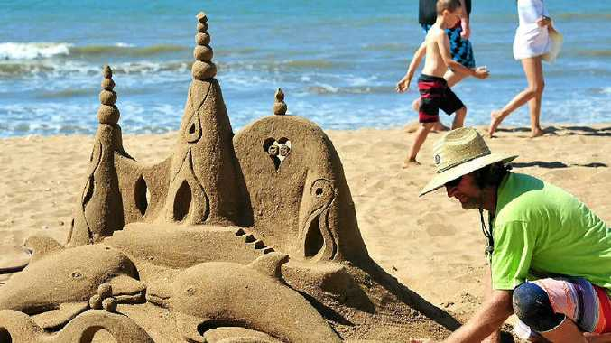 ON THE BEACH: Sandologist Steve Machell creates a stunning piece of work for the crowds that attended the Moore Park Beach Festival of Arts.