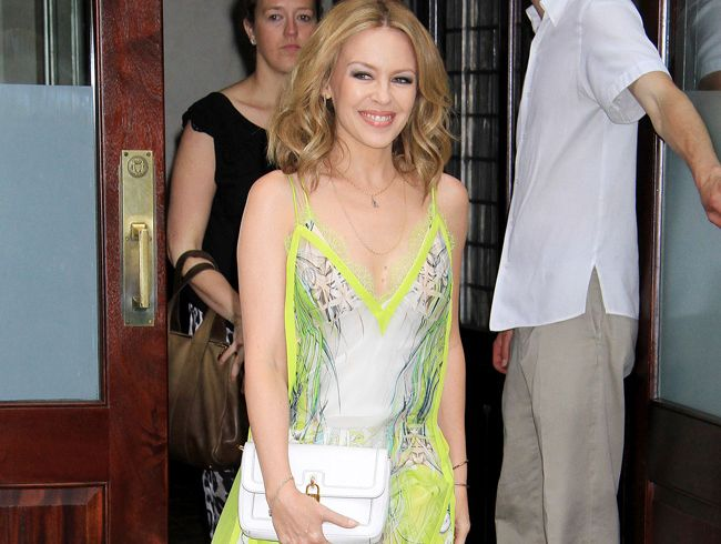 Kylie Minogue compares breast cancer surgery to going on stage.