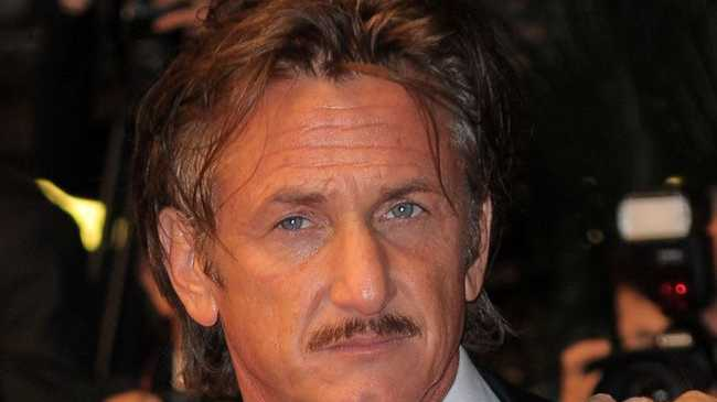 Sean Penn hindered by the paparazzi in Los Angeles.