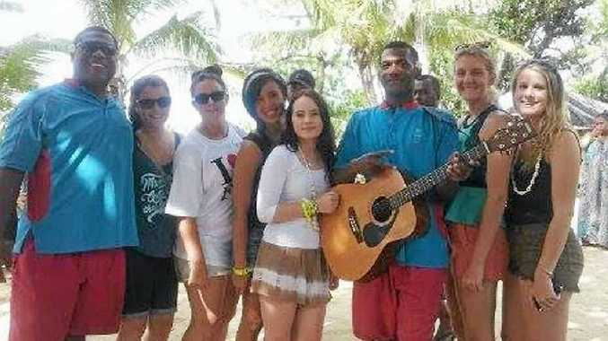 Michaela Coyle, 17, and a group of friends spent seven days in Fiji, where they experienced the culture and took part in many tourist activities, including scuba diving, snorkelling and island-hopping.