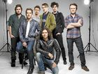 NEVER TEAR US APART: Stars of the new INXS telemovie (from left) Andy Ryan, Hugh Sheridan, Ido Drent, Luke Arnold (front), Alex Williams, Nicholas Masters and Damon Herriman.