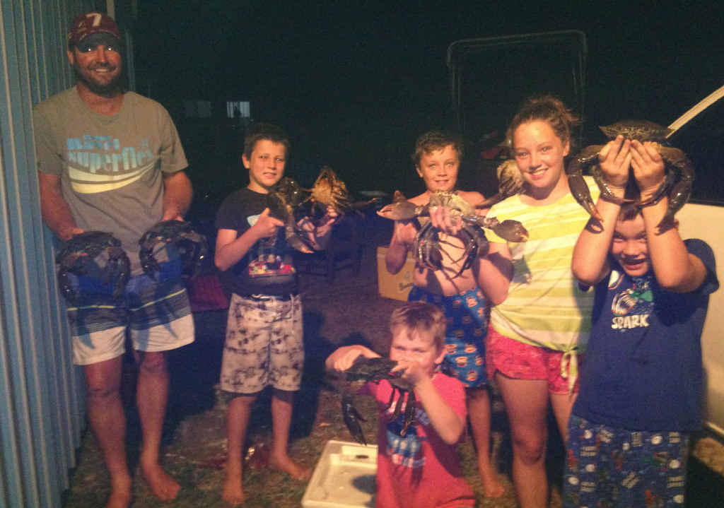 BIG HAUL: William Garrett (left) and part of the 37-crab haul from a crabbing trip to Boonaroo last weekend with (from left) Liam, Charlie and Grace Garrett and (front) Riley and Justin Weller.