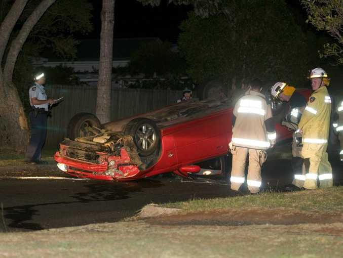 Emergency services attend a single vehicle roll over in Parsons St, Rangeville.