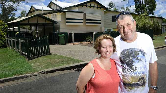 DISASTER ZONE: Nigel and Linda Grams in front of their refurbished home, which has lost about half its value since the flood.