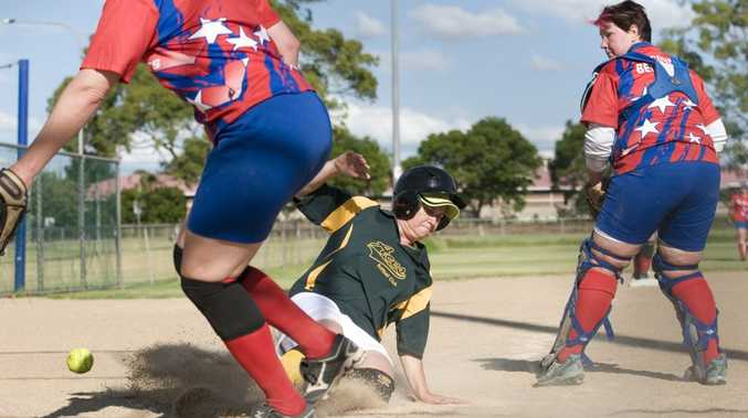 SAFE SLIDE: Peta Beutel scores a run for Aces in their A grade game against All Stars.