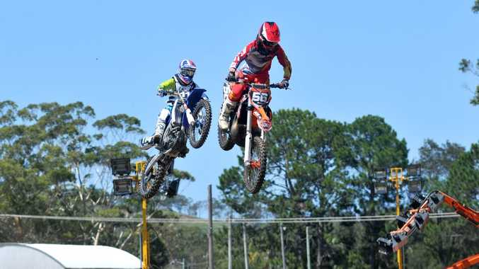 HAPPY AS A PIG IN THE MUD: Motocross riders tear through the track last Saturday at the Coffs Harbour Showgrounds.