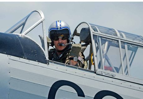 A pilot gives the thumbs up before a acrobatic display at The Great Eastern Fly-In at Evans Head.