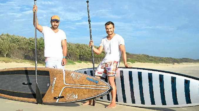 BLUE PADDLERS: Michael Leith and Tony Miller-Greenman prepare to leave Main Beach at Evans Head on their epic stand-up paddleboard ride from Brisbane to Sydney to raise money for Beyond Blue.