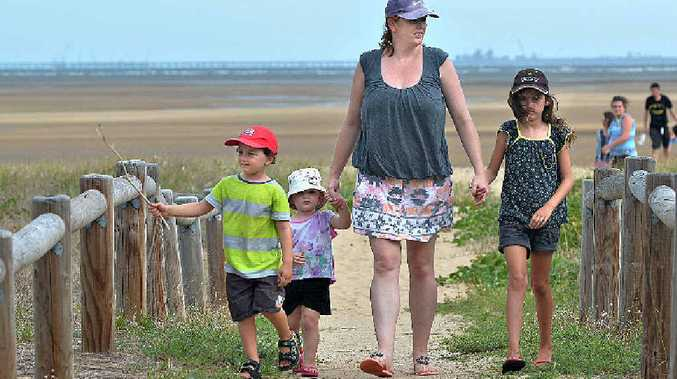 Bethaney Martin and her children, from left, Wynton, Sylvie and Estella watch their step at Town Beach after finding a used syringe and other rubbish in the area.