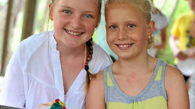 Tianna Burns, 11 (left) and Emma Russell, 10, at the SUNfest Amazing Art Race at Canoe Point, Tannum Sands.