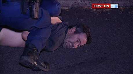 Man arrested at scene of alleged crash and police assault.