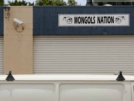 CCTV cameras keep a close eye on a property with a Mongols Nation sign above it at Morton St, Chinderah. Photo: Daily News