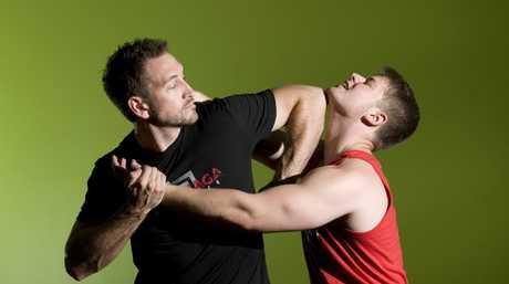 Krav Maga instructor Grant Gittins demonstrates the self-defence system on Kevin Smith.