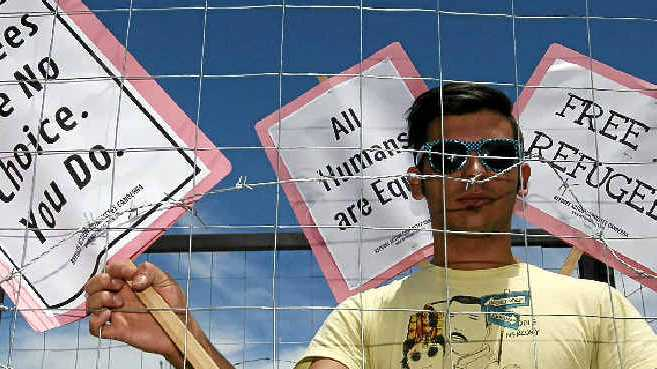 DESPERATE MEASURES: A man makes his point at a protest in support of asylum seekers in Canberra.