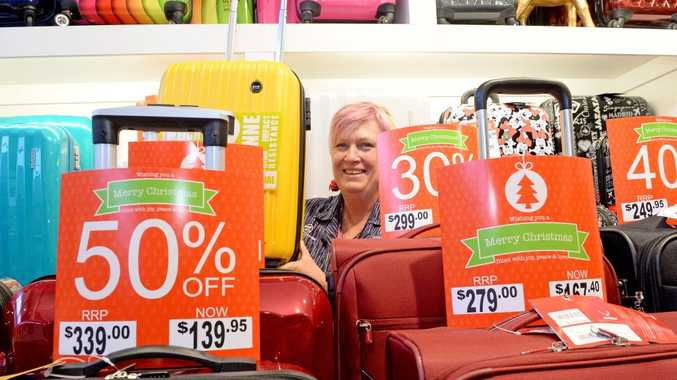 Thea Harrison from Zelow's Tweed City with some luggage on sale.