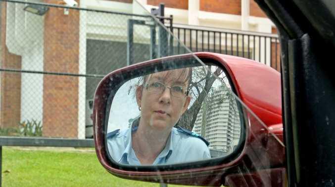 Senior Constable Emma Nicholson checks out a car with its windows down in Coolangatta.