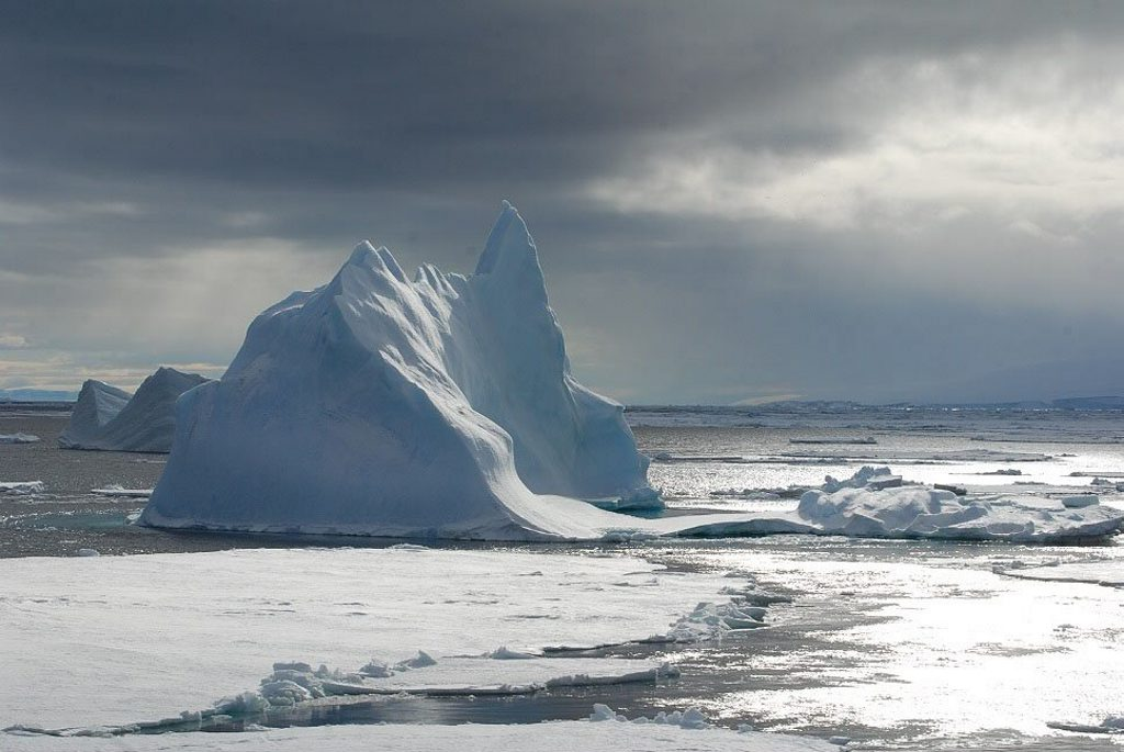 Icebergs as high as four storey buildings constantly glide by Antarctic expedition boats. Photo: Contributed (John Gardiner)