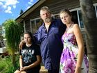 DESPERATE: Kevin Dawber of Coolana with his daughters Gypsy (left), 15, and Holly,18, are still waiting for insurance payouts following the 2011 floods.