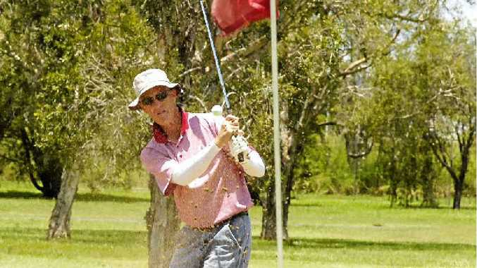 RIGHT: Lismore's John Weaver sends the sand flying as he chips to the seventh hole during the latest action at Casino Golf Club.