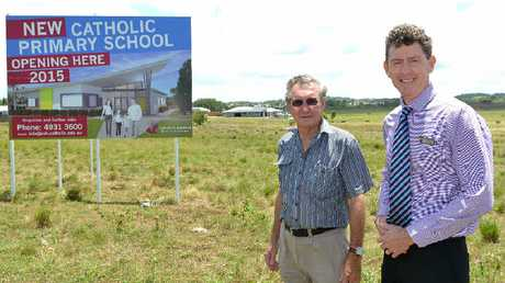 Member of the new Catholic school steering committee Ken Kelly and the assistant director of schools, northern region, of the Rockhampton Diocese Michael McCusker look over the Northern Beaches site.