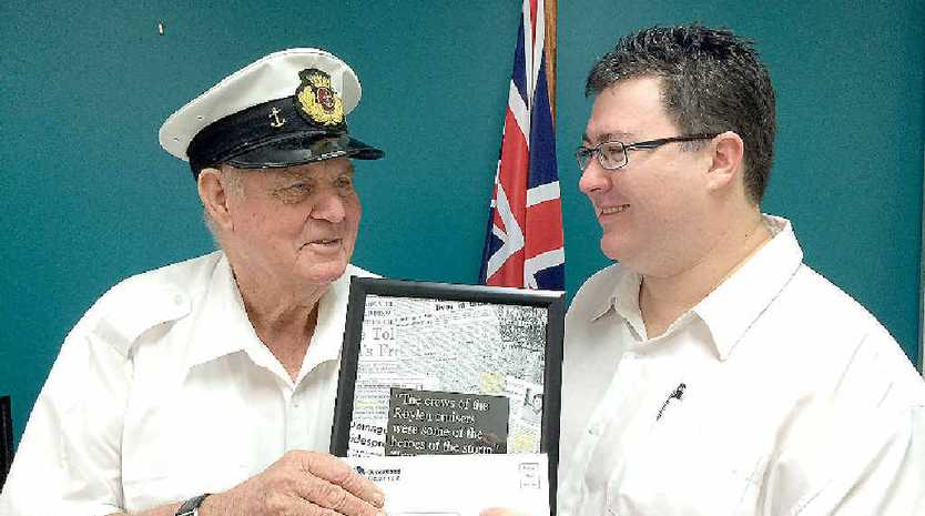 Captain John Wells receives recognition from Member for Dawson George Christensen for his efforts in evacuating people in the aftermath of Cyclone Ada in 1970.