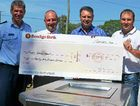 HELPING: Making out a $75,000 cheque for Laidley flood restoration are committee members Sen Sgt Jim McDonald, Bendigo Bank's David Ward, Warwick Mclean and John McGrath.