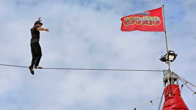 Ashley Brophy from Hudsons Circus performs on a high wire above the main circus tent.
