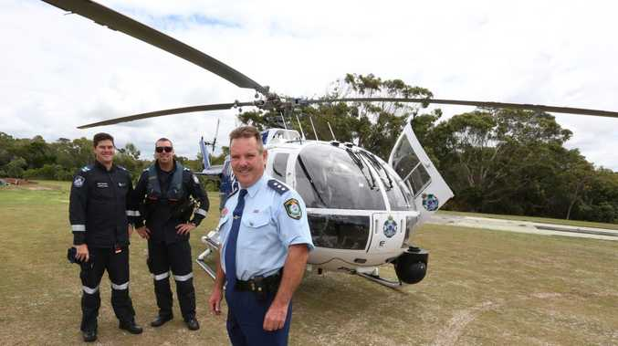 Gary Cowan with the police chopper at Pottsville earlier this week.