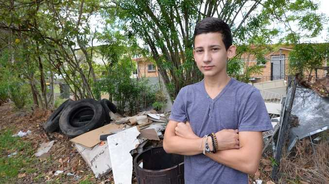 Junior Conlon in his father's yard were council has said rubbish and tyres are potential breeding grounds for mosquitoes, rats and snakes. Photo: Chris Ison / The Morning Bulletin