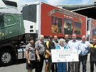 SHINING LIGHT: Daphne Nolan, Terry Nolan, Kerry Wilkins (LOTH), Adrian Nolan, Mavis Nolan (front), Darren Nolan, Iain Allison (VCV Brisbane), Steve Jones (LVRC Mayor), Glen Beutel (LOTH) and Joe White (VCV Brisbane) at the hand over of the Nolan's Transport FH 540 and the trailers promoting LOTH.