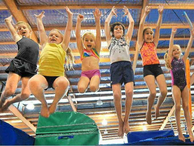 THEY'RE EXCITED: Josh Hurst, Shari Gibson, Felicity Webb, Sam Anger, Madison Kadel and Ebony Graham warm-up for the Gladstone Gymnastics sign-on day tomorrow.