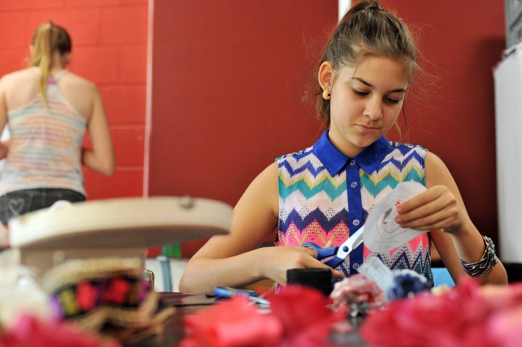 Sharnee Marshal, 13, at the SUNfest mini top hat and fascinators workshop.