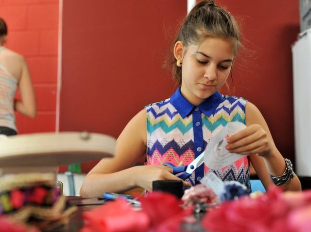 Sharnee Marshal, 13, at the SUNfest mini top hat and fascinators workshop.
