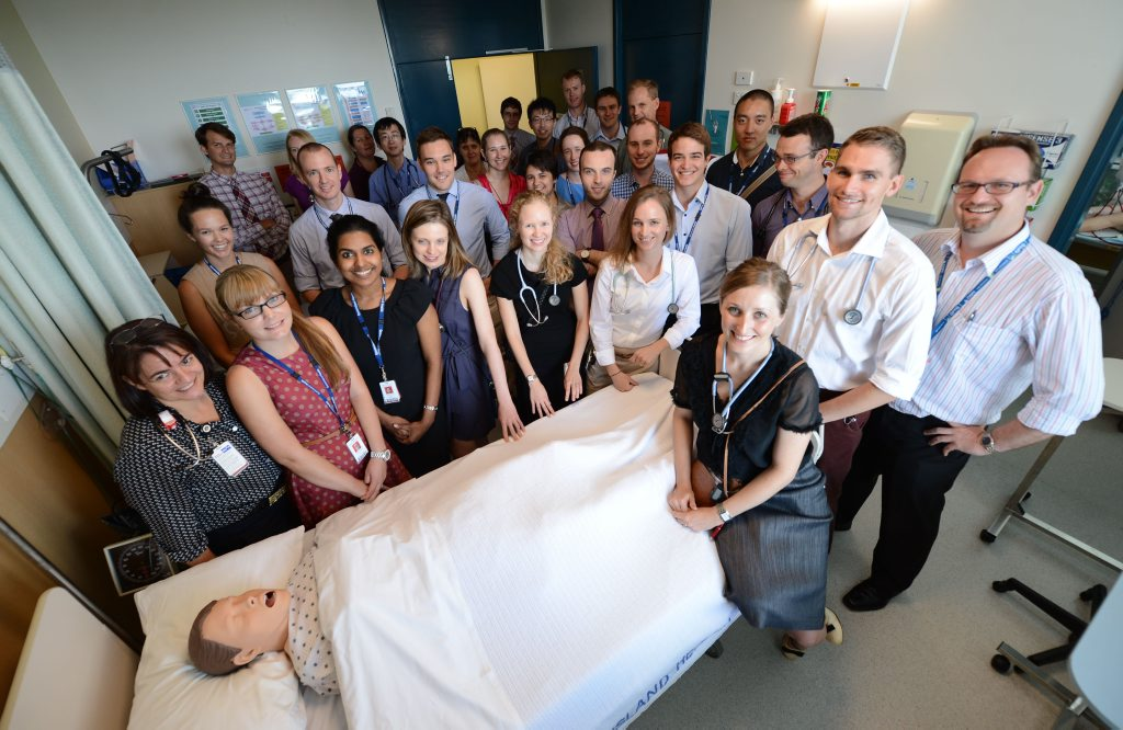 Rick Allen and Casey Bennetts (front right) with most of the 35 other new interns at the Ipswich Hospital.