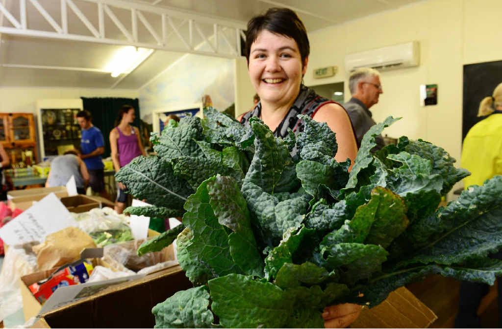TASTY: Deborah Farrell president of the Ipswich Good Food Group with some bunches of the very healthy kale plant.