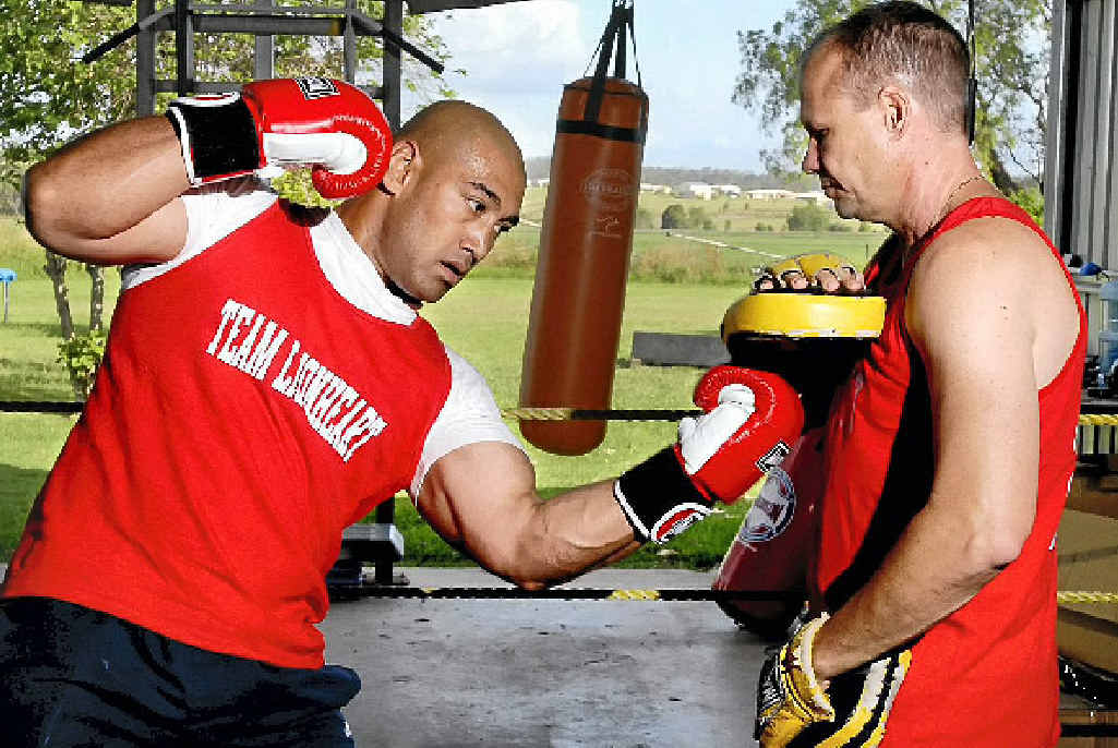 ON TARGET: World heavyweight title contender Alex Leapai (left) spars with trainer Noel Thornberry in Toowoomba.