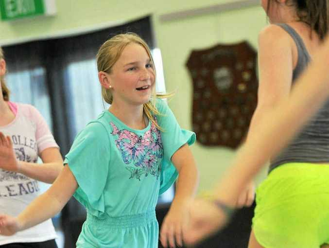 MOVE IT: Danika Hogg, 12, at a recent SUNfest workshop, practising a Flash Mob performance.