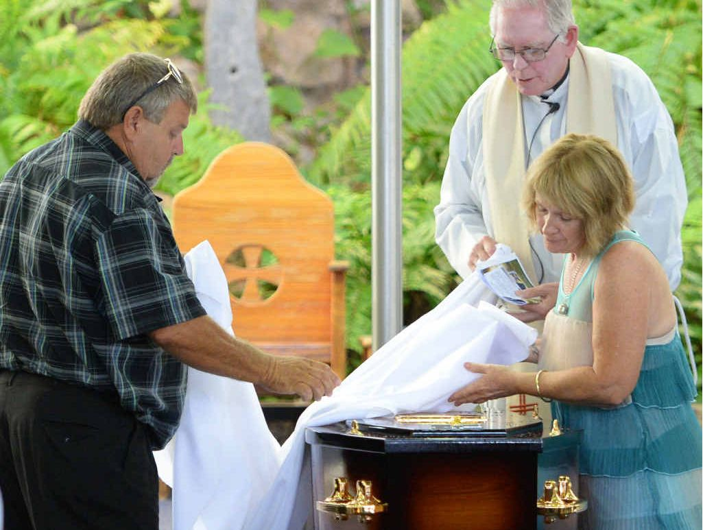 Kelvin and Roxanne West place the pall on the casket at the funeral of Kurtis West held at the Holy Family Catholic Church. Photo: Chris Ison / The Morning Bulletin