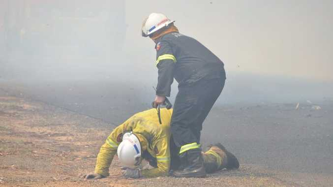 BURNT OUT: A firefighter collapsed from suspected smoke inhalation at a Kingaroy home today.