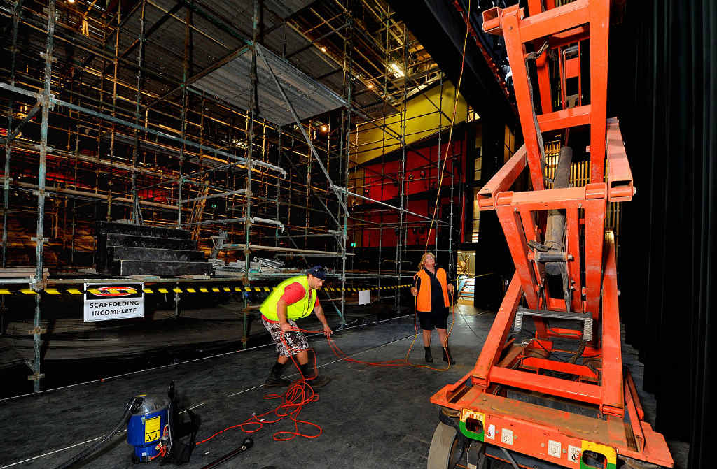 CLEAN-UP: Louis Heartland and Linda Khan, from Steamatic, are part of the workforce cleaning the Brolga Theatre. The auditorium is lined with scaffolding to the ceiling.