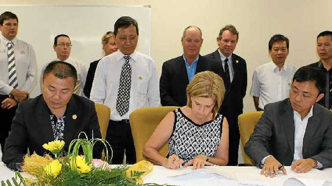 CAEAI president Raymond Wang, Whitsunday Mayor Jennifer Whitney and Esteem Capital director Jason Ji at the signing ceremony.